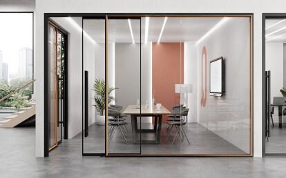 "QUADRO. Black anodized finish and light oak wood veneer snap-on trim, framed sliding door with 45"" ladder pull hardware."