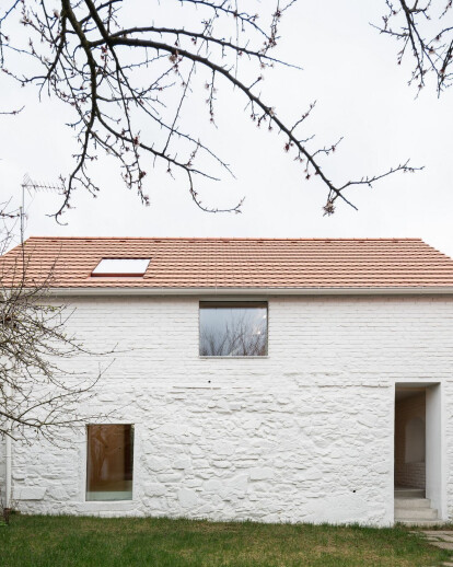 Atelier 111 architekti connects two houses in historical center of Czech village to transform into their family home