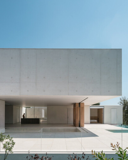 Two villas by Atelier Stéphane Fernandez exhibit a subtle yet powerful presence in the landscape